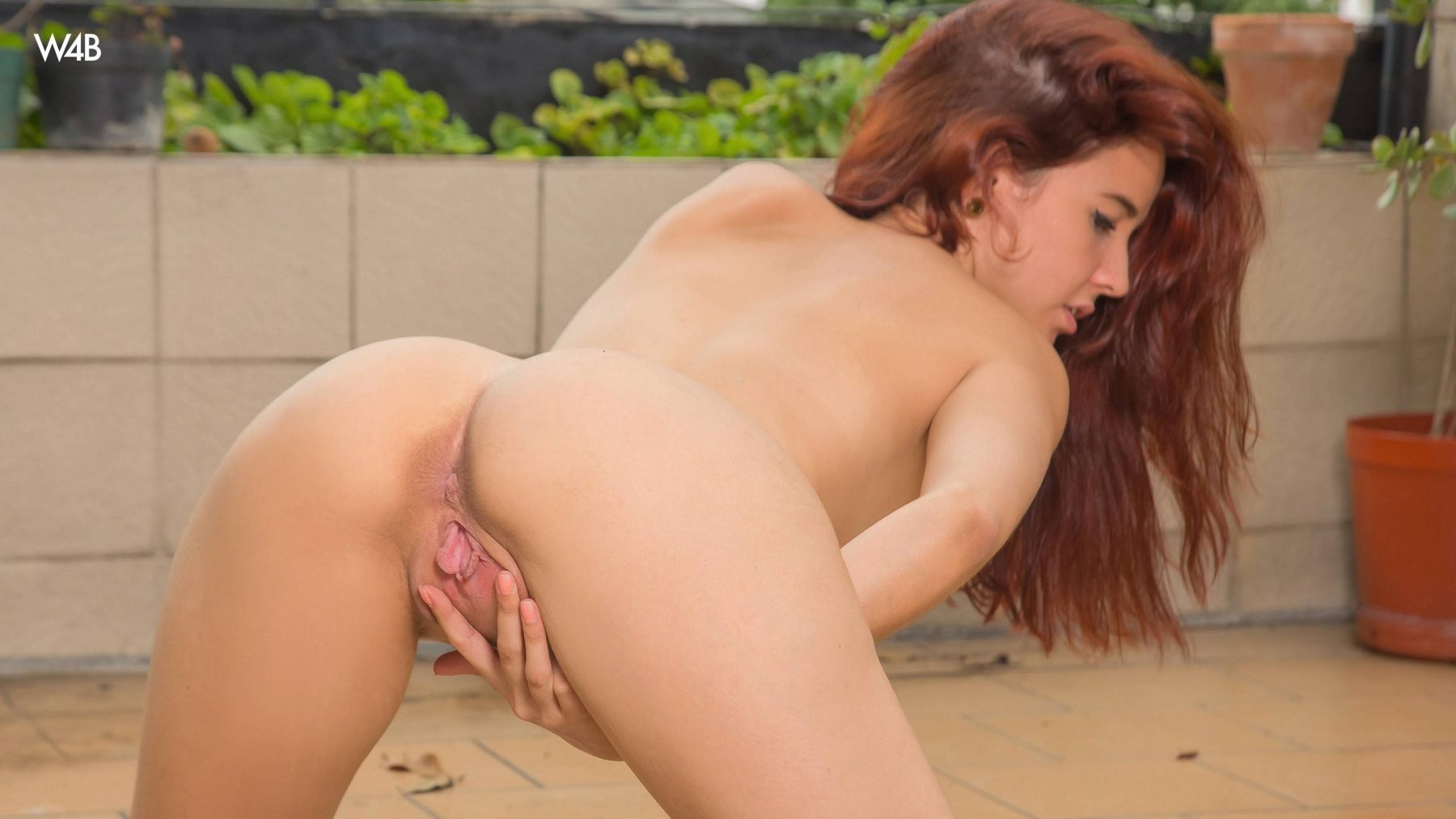 image Nude redhead with nice tits and ass is whipped in bdsm dungeon