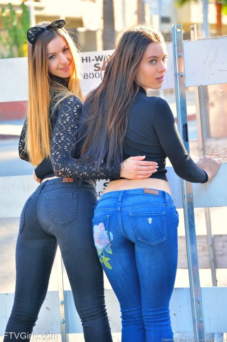 Lana Rhoades and her lesbian friend posing in tight jeans showing their amazing butts