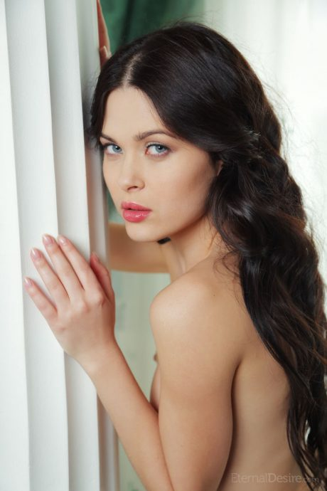 Stunning brunette eve naked on a chair by the window 10 greatnass.com_