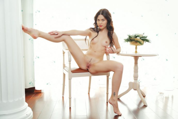 Stunning brunette eve naked on a chair by the window 6 greatnass.com_
